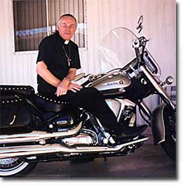 Father Joshua on a motorcycle